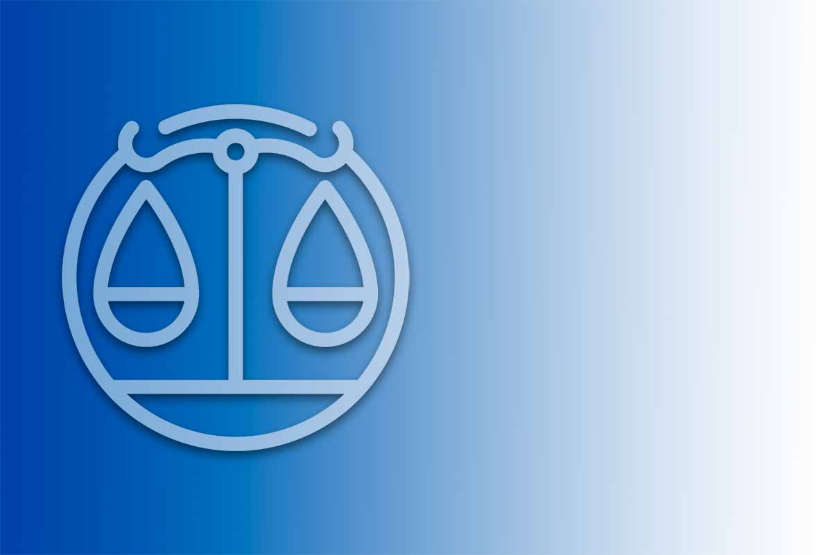 White silhouette of the Libra Zodiac sign on a blue gradient background