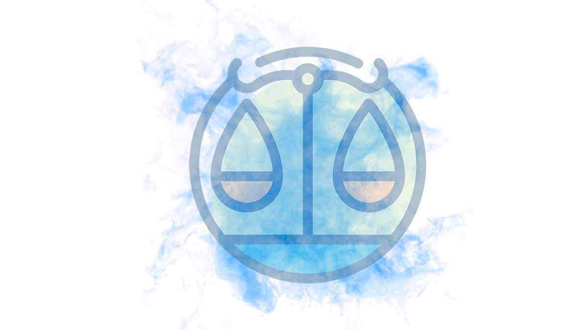 The Libra sign on a blue smoky blackground